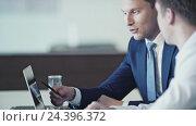 Купить «Young businessmen at a meeting in office», видеоролик № 24396372, снято 7 декабря 2019 г. (c) Raev Denis / Фотобанк Лори