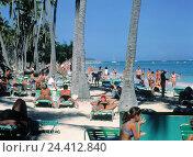 Купить «The Dominican Republic, Punta Cana, Bavaro Beach Resort, beach scene vacation, east coast, Costa del Coco, beach, hotel beach, palm beach, sandy beach...», фото № 24412840, снято 12 июля 2000 г. (c) mauritius images / Фотобанк Лори