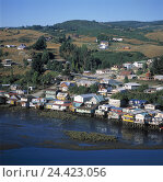 Купить «Chile, Chiloe island, Castro, town view, Rio Gamboa, South America, region de off Lagos, river, shore, building on stilts, residential houses, hill scenery, scenery, outside», фото № 24423056, снято 21 мая 2003 г. (c) mauritius images / Фотобанк Лори