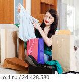 Купить «woman with shopping bags», фото № 24428580, снято 11 января 2019 г. (c) Яков Филимонов / Фотобанк Лори