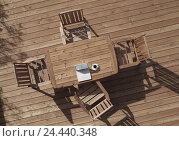 Купить «Terrace, wooden floor, chairs, table, notebook computer, coffee cup, from above balcony, planking floor, wooden floor, wooden table, wooden, wooden chairs...», фото № 24440348, снято 6 ноября 2003 г. (c) mauritius images / Фотобанк Лори