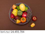 Купить «Exotic fruit basket», фото № 24455784, снято 20 февраля 2019 г. (c) mauritius images / Фотобанк Лори