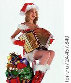 Купить «Woman, lining, Santa Claus, concertina, pouch, presents Christmas, female, costume, sing, hymn praise, cut out», фото № 24457840, снято 8 февраля 2001 г. (c) mauritius images / Фотобанк Лори