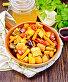 Жаркое с овощами и медом в сковороде на полотенце, фото № 24461092, снято 16 октября 2016 г. (c) Резеда Костылева / Фотобанк Лори