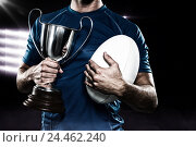 Купить «Composite image 3D of rugby player holding trophy and ball», фото № 24462240, снято 27 июня 2019 г. (c) Wavebreak Media / Фотобанк Лори