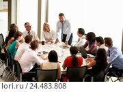 Купить «Businessman Addressing Meeting Around Boardroom Table», фото № 24483808, снято 20 октября 2013 г. (c) easy Fotostock / Фотобанк Лори
