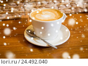 Купить «close up of coffee cup with heart shape drawing», фото № 24492040, снято 1 декабря 2015 г. (c) Syda Productions / Фотобанк Лори
