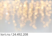 Купить «christmas decoration or garland lights bokeh», фото № 24492208, снято 15 октября 2016 г. (c) Syda Productions / Фотобанк Лори