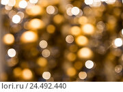 Купить «blurred golden christmas lights bokeh», фото № 24492440, снято 3 ноября 2016 г. (c) Syda Productions / Фотобанк Лори