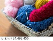 Купить «basket with knitting needles and balls of yarn», фото № 24492456, снято 20 октября 2016 г. (c) Syda Productions / Фотобанк Лори
