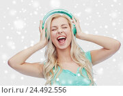 Купить «happy young woman or teenage girl with headphones», фото № 24492556, снято 13 февраля 2016 г. (c) Syda Productions / Фотобанк Лори