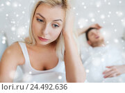 awake woman having insomnia in bed. Стоковое фото, фотограф Syda Productions / Фотобанк Лори