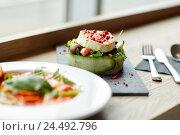 Купить «goat cheese salad and gazpacho soup at restaurant», фото № 24492796, снято 22 сентября 2016 г. (c) Syda Productions / Фотобанк Лори