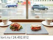 Купить «salad, sandwich and matcha green tea at restaurant», фото № 24492812, снято 22 сентября 2016 г. (c) Syda Productions / Фотобанк Лори