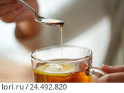 Купить «close up of woman adding honey to tea with lemon», фото № 24492820, снято 13 октября 2016 г. (c) Syda Productions / Фотобанк Лори