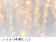 Купить «christmas decoration or garland lights bokeh», фото № 24492832, снято 15 октября 2016 г. (c) Syda Productions / Фотобанк Лори