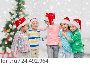 Купить «happy little children in christmas santa hats», фото № 24492964, снято 31 января 2016 г. (c) Syda Productions / Фотобанк Лори