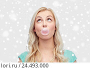 Купить «happy young woman or teenage girl chewing gum», фото № 24493000, снято 13 февраля 2016 г. (c) Syda Productions / Фотобанк Лори
