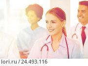 Купить «happy doctor over group of medics at hospital», фото № 24493116, снято 14 марта 2015 г. (c) Syda Productions / Фотобанк Лори