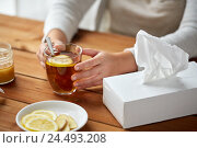 Купить «close up of ill woman drinking tea with lemon», фото № 24493208, снято 13 октября 2016 г. (c) Syda Productions / Фотобанк Лори