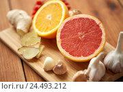 Купить «grapefruit, ginger, garlic and orange on board», фото № 24493212, снято 13 октября 2016 г. (c) Syda Productions / Фотобанк Лори