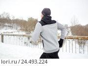 Купить «man running along snow covered winter bridge road», фото № 24493224, снято 10 ноября 2016 г. (c) Syda Productions / Фотобанк Лори