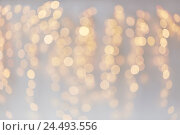 Купить «christmas decoration or garland lights bokeh», фото № 24493556, снято 15 октября 2016 г. (c) Syda Productions / Фотобанк Лори