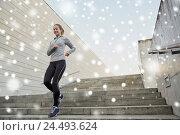 Купить «happy sporty woman running downstairs in city», фото № 24493624, снято 17 октября 2015 г. (c) Syda Productions / Фотобанк Лори