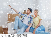 Купить «couple with boxes moving to new home and dreaming», фото № 24493708, снято 25 февраля 2016 г. (c) Syda Productions / Фотобанк Лори