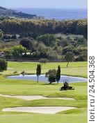 Купить «Spain, the Balearic Islands, island Majorca, Pula, golf course, pond, trees, turfs, Green's keepers, turf mowing, no model release,», фото № 24504368, снято 2 июня 2009 г. (c) mauritius images / Фотобанк Лори