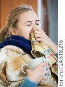 Купить «Young woman suffering of cold and having stuffy nose», фото № 24518216, снято 21 апреля 2019 г. (c) Яков Филимонов / Фотобанк Лори