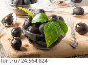 Купить «Черные оливки в стеклянной посуде», фото № 24564824, снято 29 ноября 2016 г. (c) Vlad Romensky / Фотобанк Лори