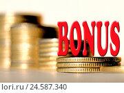 """Символ """" bonus """" на фоне столбиков монет. Стоковое фото, фотограф Сергеев Валерий / Фотобанк Лори"""