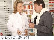 Купить «Patient with cold in chemist's shop,», фото № 24594848, снято 15 апреля 2011 г. (c) mauritius images / Фотобанк Лори
