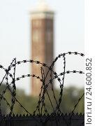 Купить «Fair tower, barbed wire, fence, tower, trees, Germany, North Rhine-Westphalia, Cologne, fair,», фото № 24600852, снято 24 марта 2019 г. (c) mauritius images / Фотобанк Лори
