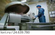 Купить «Industrial production of food. mixing meat machine», видеоролик № 24639780, снято 30 сентября 2016 г. (c) Илья Насакин / Фотобанк Лори