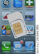 Купить «iPhone, SIM card, display,», фото № 24644980, снято 15 мая 2011 г. (c) mauritius images / Фотобанк Лори