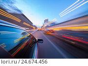 Купить «Размытое движение автомобиля по ночной улице», фото № 24674456, снято 3 мая 2016 г. (c) Виталий Поздеев / Фотобанк Лори