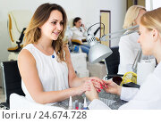 Купить «Female clients doing nails in nail salon in afternoon», фото № 24674728, снято 2 ноября 2016 г. (c) Яков Филимонов / Фотобанк Лори