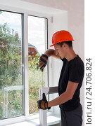 Купить «Монтаж и ремонт пластиковых окон», фото № 24706824, снято 6 июня 2006 г. (c) Myroslav Kuchynskyi / Фотобанк Лори