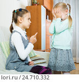 Купить «girl lecturing little sister in domestic interior», фото № 24710332, снято 19 апреля 2019 г. (c) Яков Филимонов / Фотобанк Лори