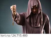 Купить «Monk in religious concept on gray background», фото № 24715480, снято 26 октября 2016 г. (c) Elnur / Фотобанк Лори