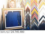 Купить «Cheerful workman holding wooden picture framing moulding», фото № 24745480, снято 20 августа 2018 г. (c) Яков Филимонов / Фотобанк Лори