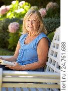 Купить «Senior woman reading in garden», фото № 24761688, снято 1 марта 2011 г. (c) easy Fotostock / Фотобанк Лори