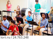 Купить «Pupils Playing Musical Instruments In School Orchestra», фото № 24763248, снято 12 апреля 2014 г. (c) easy Fotostock / Фотобанк Лори