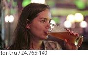 Купить «girl sits with beer glass», видеоролик № 24765140, снято 28 сентября 2016 г. (c) Яков Филимонов / Фотобанк Лори