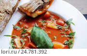 Купить «plate of delicious gazpacho soup at restaurant», видеоролик № 24781392, снято 29 сентября 2016 г. (c) Syda Productions / Фотобанк Лори