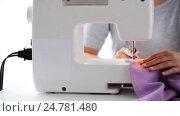 Купить «tailor woman with sewing machine stitching fabric», видеоролик № 24781480, снято 3 октября 2016 г. (c) Syda Productions / Фотобанк Лори