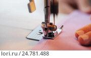 Купить «sewing machine presser foot stitching fabric», видеоролик № 24781488, снято 3 октября 2016 г. (c) Syda Productions / Фотобанк Лори