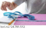 Купить «tailor woman with measuring tape and fabric», видеоролик № 24781512, снято 3 октября 2016 г. (c) Syda Productions / Фотобанк Лори